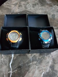 two digital watches in box