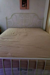 brown wooden bed frame with white mattress 49 km