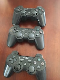 two black Sony PS3 controllers