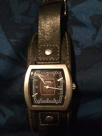 square silver Fossil chronograph watch with black leather band