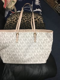White and gold mk bag