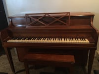 Brown wooden upright piano Valley Stream, 11580
