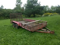 brown and black utility trailer 245 mi