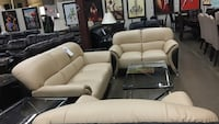 Two tone bonded leather sofa and love seat.