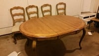 oval brown wooden dining table with chairs set Stroudsburg, 18360
