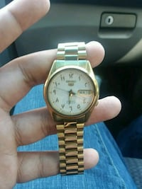 round gold-colored analog watch with link bracelet West Palm Beach, 33407