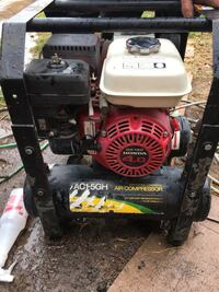 black, red, and white air compressor Fresno, 93705