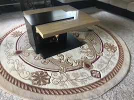 Ottoman, two accent chairs, lamps, three coffee tables