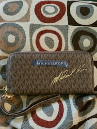 brown and black monogrammed Coach leather wristlet Centreville, 20120