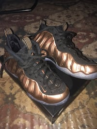 pair of black-and-brown Nike Foamposite shoes