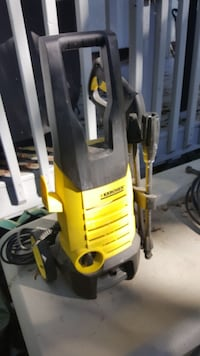 black and yellow Karcher pressure washer