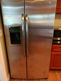 stainless steel side-by-side refrigerator with dispenser