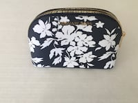 Michael Kors Black and white floral wristlet Milton, L9T 8B6