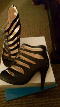 pair of black leather gladiator sandals Glasgow, 42141
