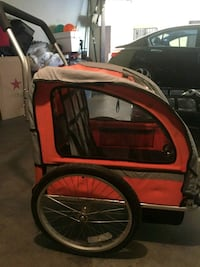 red and black bicycle trailer