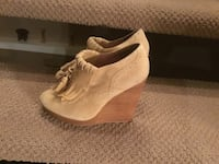 pair of brown suede wedge shoes Calgary, T2T 2H3