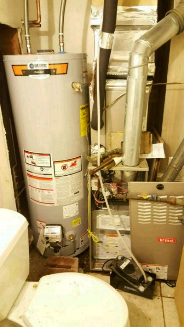 gray and red water heater tank