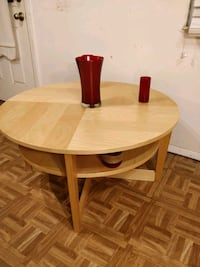 Like new wooden round table with shelf in great co 33 km