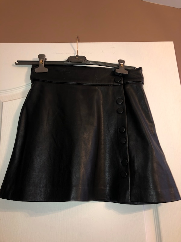 Woman's faux leather skirt with buttons 17a21b9c-a632-4395-a130-1d869d9197d3