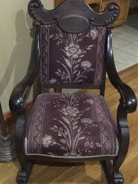Brown and white floral armchair$250.00