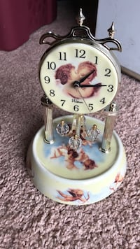 An exquisitely beautiful Angel Clock. With for Crystal spinning balls  It works great. Fairfax, 22030