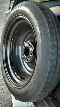 145/80/R 17 Spare donut tire on rim