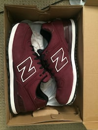 Pair of red New Balance low-top sneakers Toronto, M9P 3B5