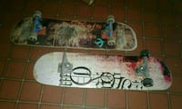 two white and brown skateboards