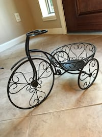 black tricycle planter