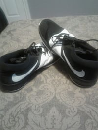 pair of black-and-white Nike sneakers Surrey