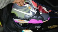 pair of gray-and-pink Nike sneakers sz12