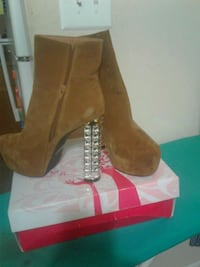 Size 10 pair of brown suede heeled boots Alexandria