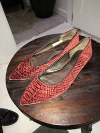 Pair of red snake-print pointed-toe flats