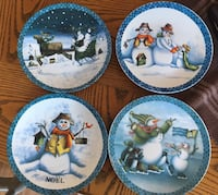 four white-and-blue ceramic decorative plates with Snowman print