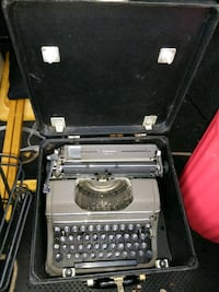 gray and black typewriter in case Fairmount Heights, 20743