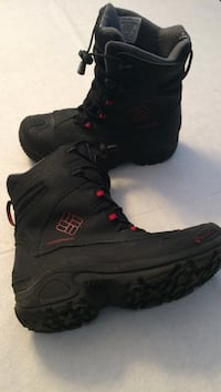 pair of black Columbia boots
