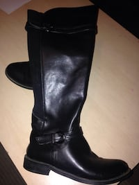 pair of black leather boots 3736 km