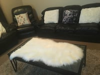 Black leather 3-seat sofa with pillows and coffee table . Calgary, T2A 7Z2
