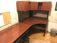 brown wooden sectional desk with cabinets