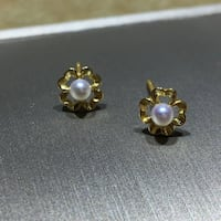 two gold-colored and black gemstone earrings 1161 mi