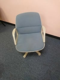 gray and white padded armchair