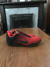 unpaired red and black Nike basketball shoe Winnipeg, R2H 1T2