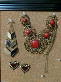 gold and red gemstone pendant necklace