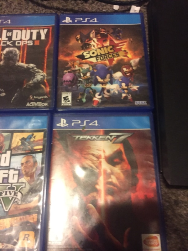 PS4 with all cords and 8 games but no controller