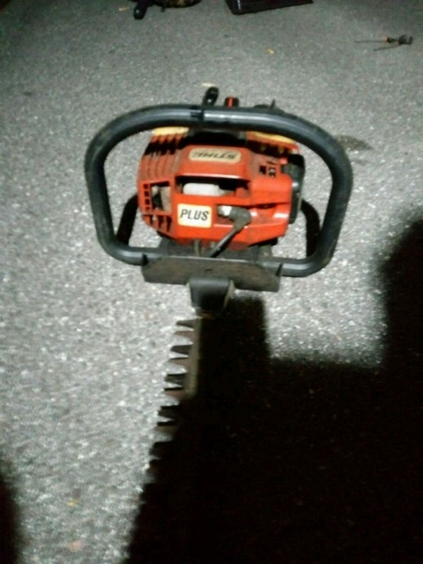 orange and black chainsaw