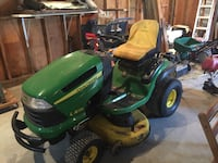 John Dere Ride Mower and two mowers and two weed wackers