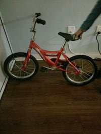 toddler's red and white bicycle Bronx, 10451