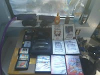 black Sony PS3 game console with game cases Ukiah, 95482