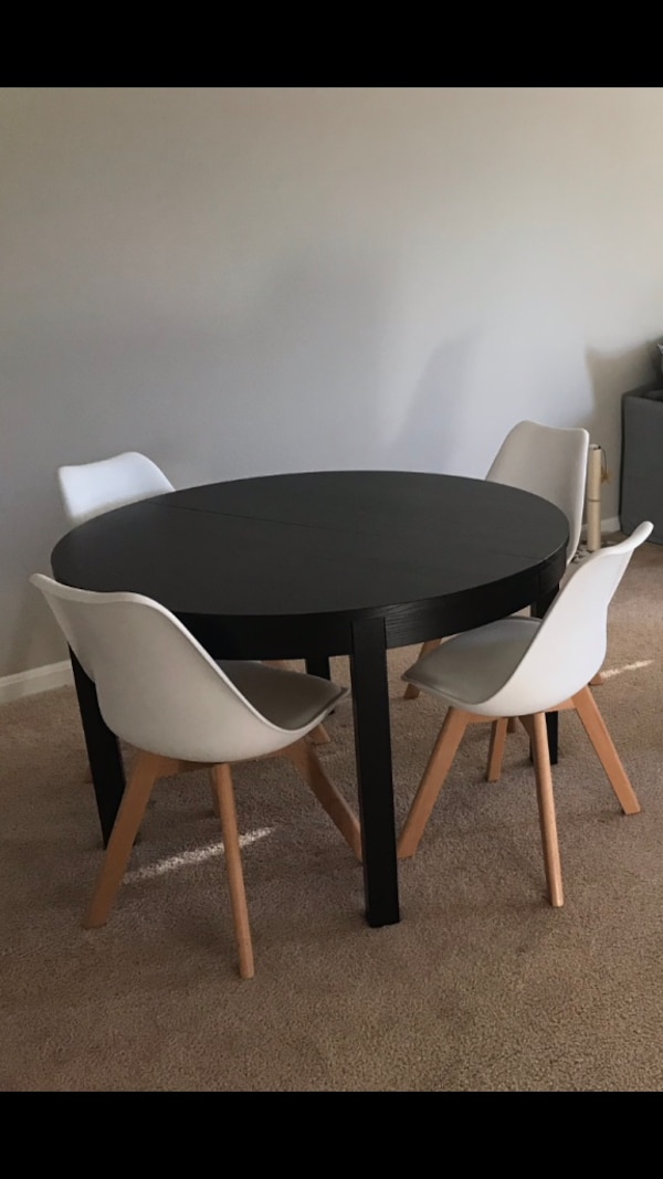 Four modern white and wood dining chairs