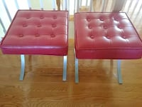 2 red faux leather ottomans